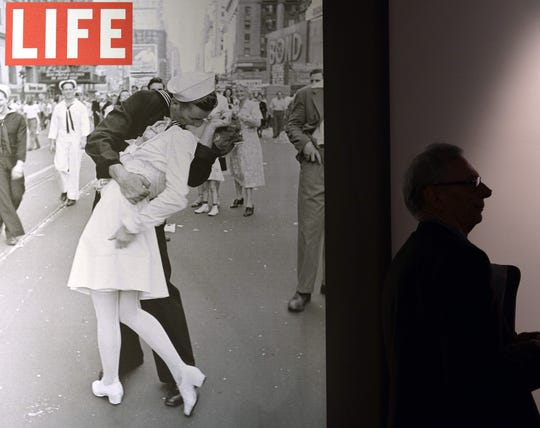 "A visitor walks past ""VJ Day in Times Square, New York, NY, 1945"" by Alfred Eisenstaedt during the ""Life I grandi fotografi"", (The great photographers) exhibition in Rome."