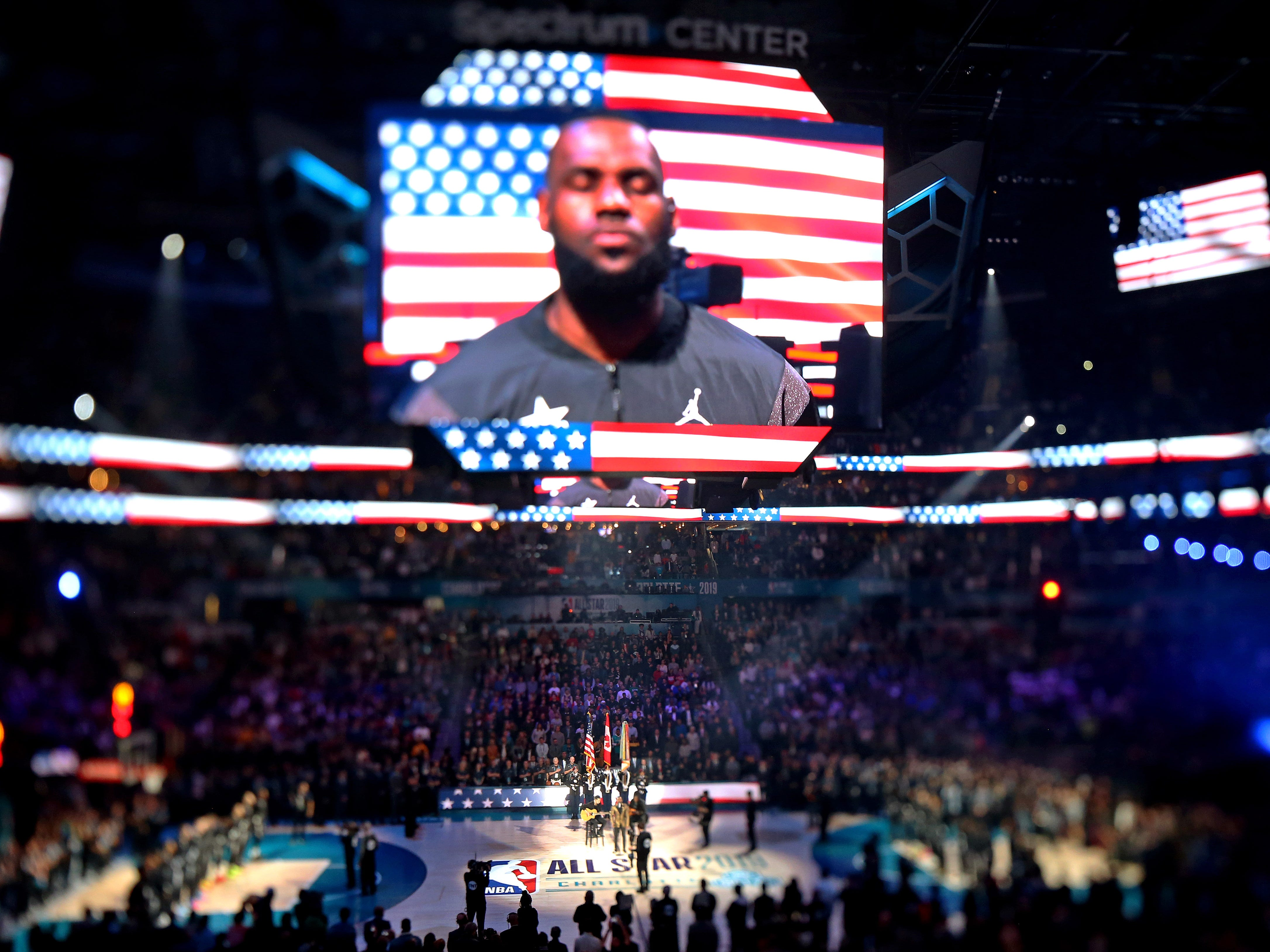 LeBron James is shown on the jumbotron during the national anthem before the All-Star Game.