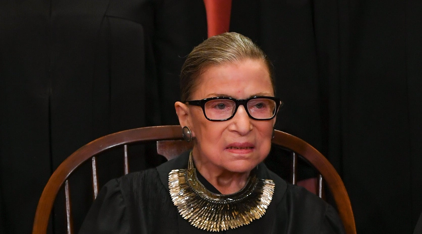 Supreme Court Associate Justice Ruth Bader Ginsburg sits for the court's annual portrait in November, three weeks before undergoing surgery for lung cancer.