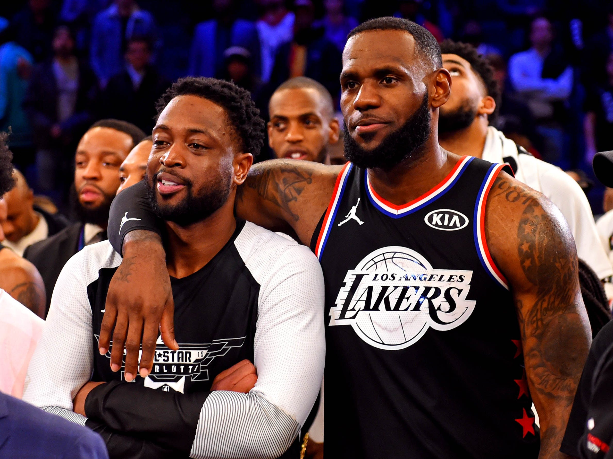 LeBron James and Dwyane Wade share a moment after the All-Star Game.
