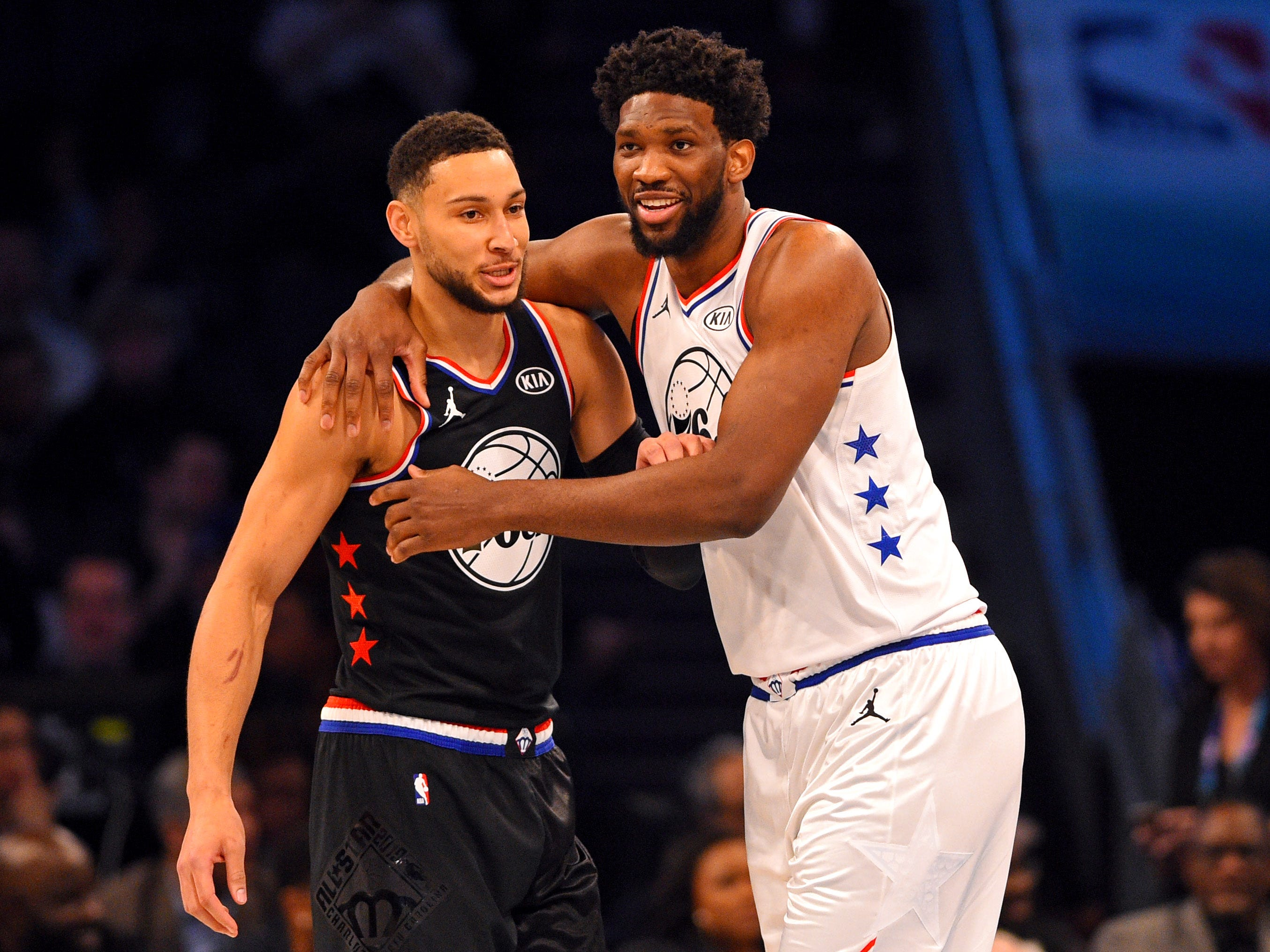 Joel Embiid hugs 76ers teammate Ben Simmons during the All-Star Game.