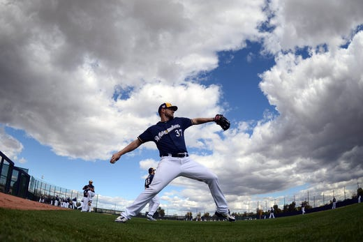 Feb.16: Brewers pitcher Adrian Houser throws during a workout.