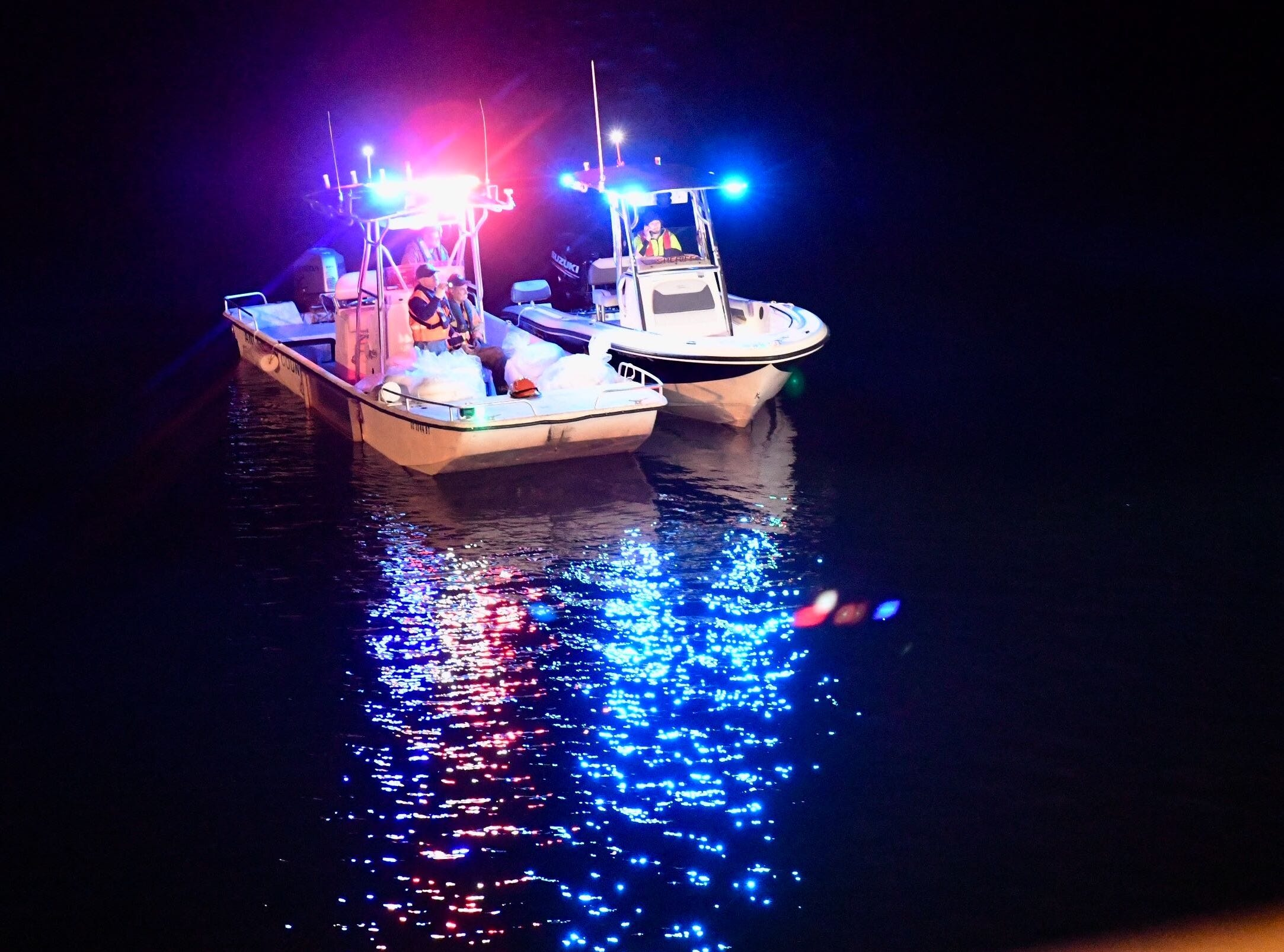 Anderson County Hazardous Materials boats on Lake Hartwell in Anderson near the 18- wheeler wreck on Monday, Feb. 18, 2019.