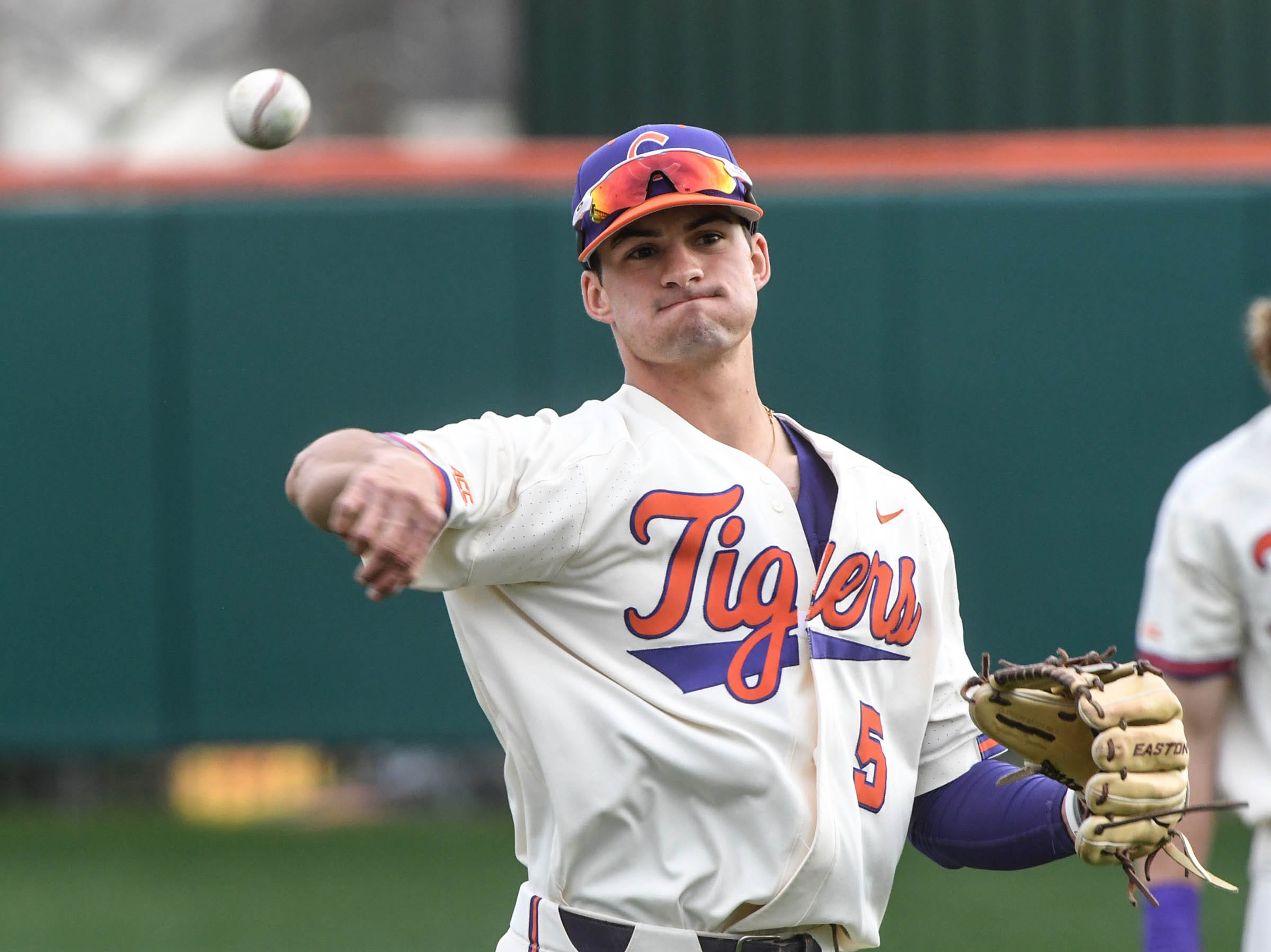 Clemson sophomore Sam Hall(5) warms up before the game with Charlotte at Doug Kingsmore Stadium in Clemson Monday, February 18, 2019.