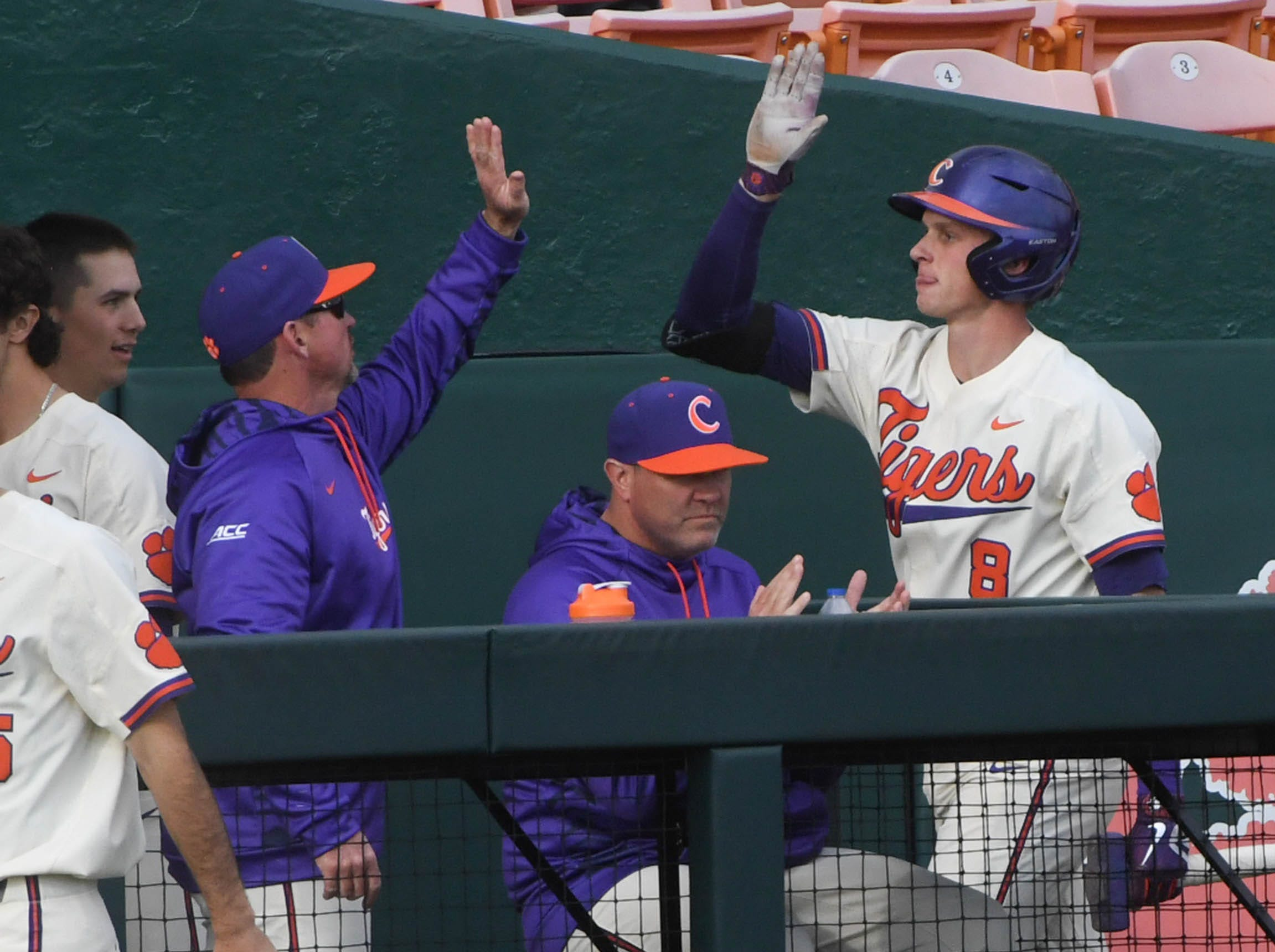 Clemson junior Logan Davidson(8) gets a high-five from Clemson head coach Monte Lee, left, after he hit a home run against Charlotte during the bottom of the first inning at Doug Kingsmore Stadium in Clemson Monday, February 18, 2019.