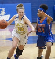 Richland Northeast's Tajayia Wiggins (21) guards Wren's Cassidy Bell (15) during the game at Wren High School earlier this season. Bell has been named the 2018-19 Region 1-AAAA Player of the Year.