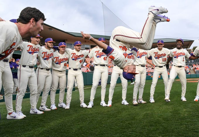 Clemson junior Owen Griffith(40) does a backflip during a team huddle, before the game with Charlotte at Doug Kingsmore Stadium in Clemson Monday, February 18, 2019.