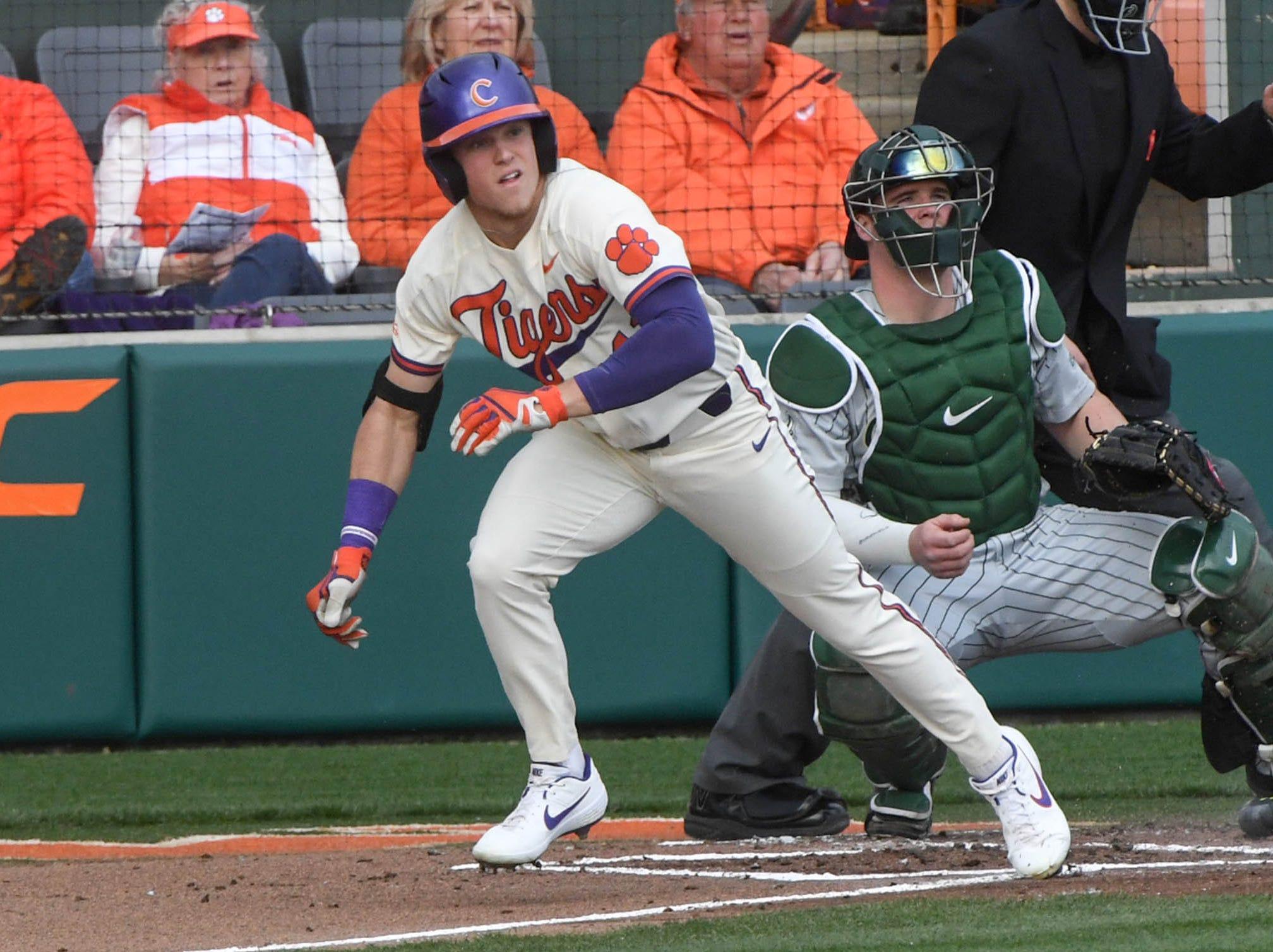 Clemson sophomore Michael Green(11) swings against Charlotte during the bottom of the first inning at Doug Kingsmore Stadium in Clemson Monday, February 18, 2019.