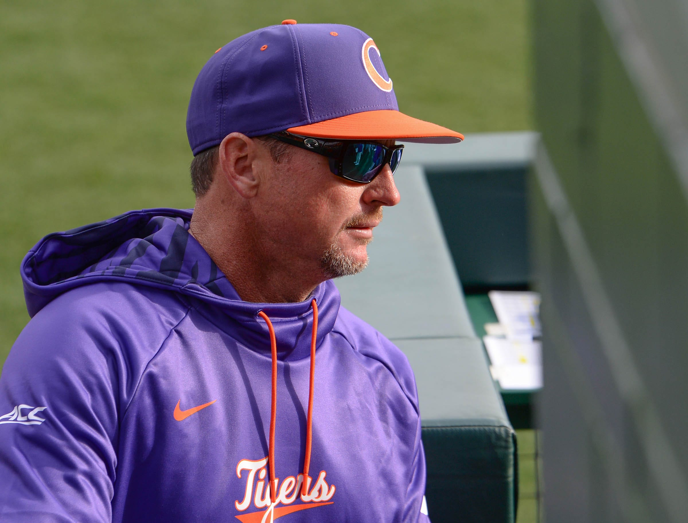 Clemson head coach Monte Lee looks in the dugout during the bottom of the second inning of the game with Charlotte at Doug Kingsmore Stadium in Clemson Monday, February 18, 2019.
