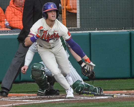 Clemson sophomore Michael Green(11) swings against Charlotte during the bottom of the first inning at Doug Kingsmore Stadium in Clemson Monday, February 18, 2019.