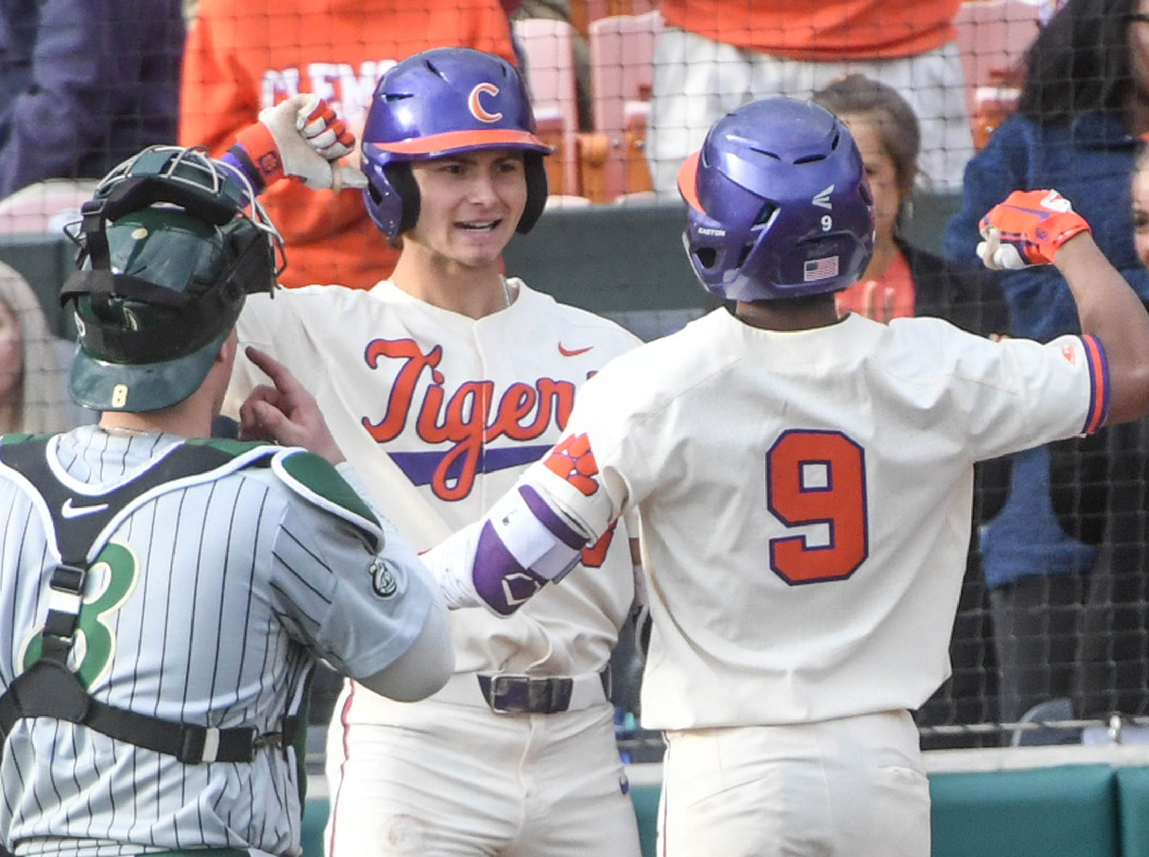 Clemson infielder Jordan Greene(9) celebrates with Clemson sophomore Bryce Teodosio(13) after hitting a home run against Charlotte during the bottom of the second inning at Doug Kingsmore Stadium in Clemson Monday, February 18, 2019.