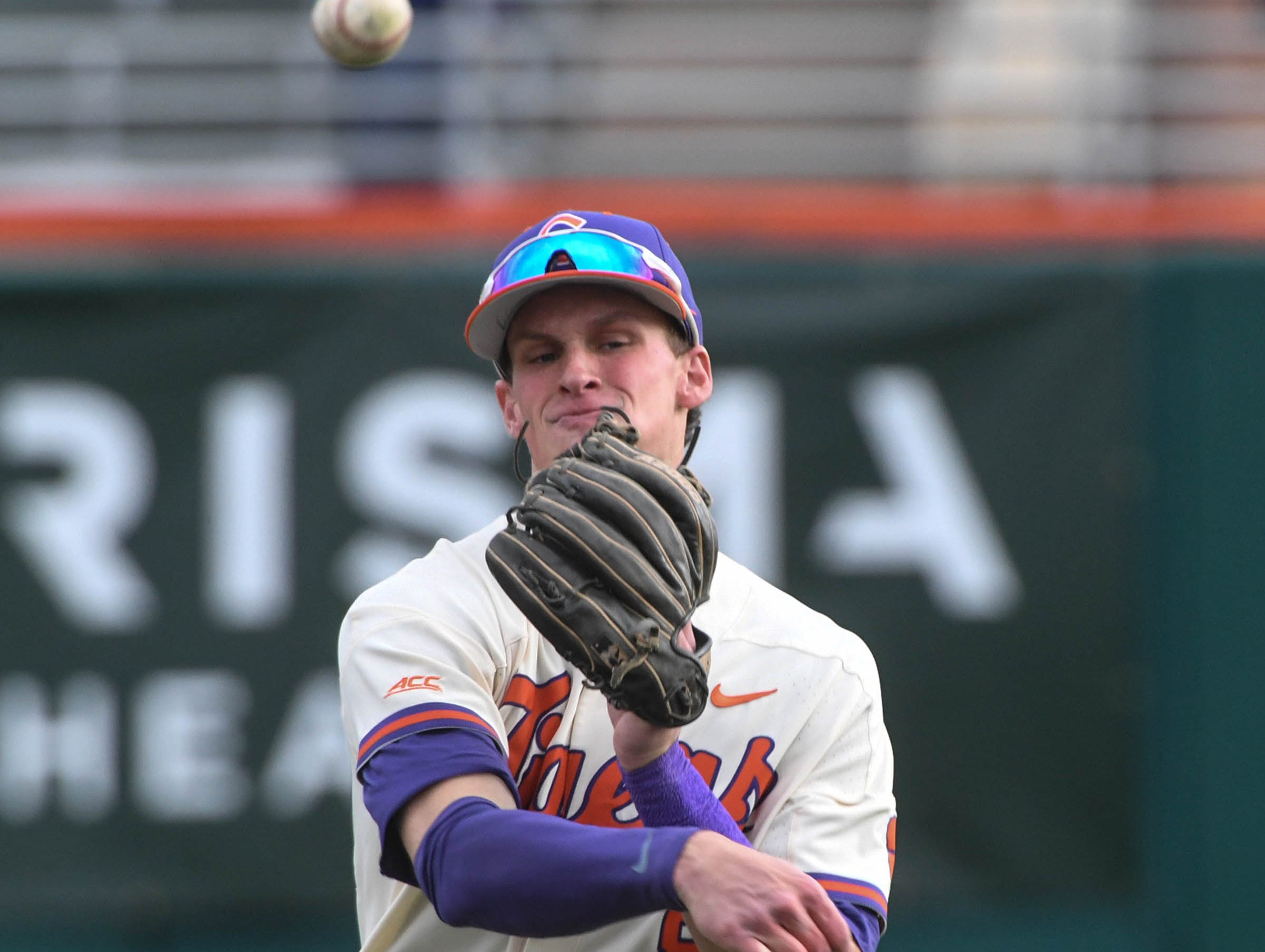 Clemson junior Logan Davidson(8) warms up before the game with Charlotte at Doug Kingsmore Stadium in Clemson Monday, February 18, 2019.