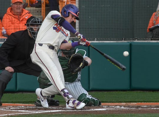 Clemson junior Logan Davidson(8) hits a home run against Charlotte during the bottom of the first inning at Doug Kingsmore Stadium in Clemson Monday, February 18, 2019.
