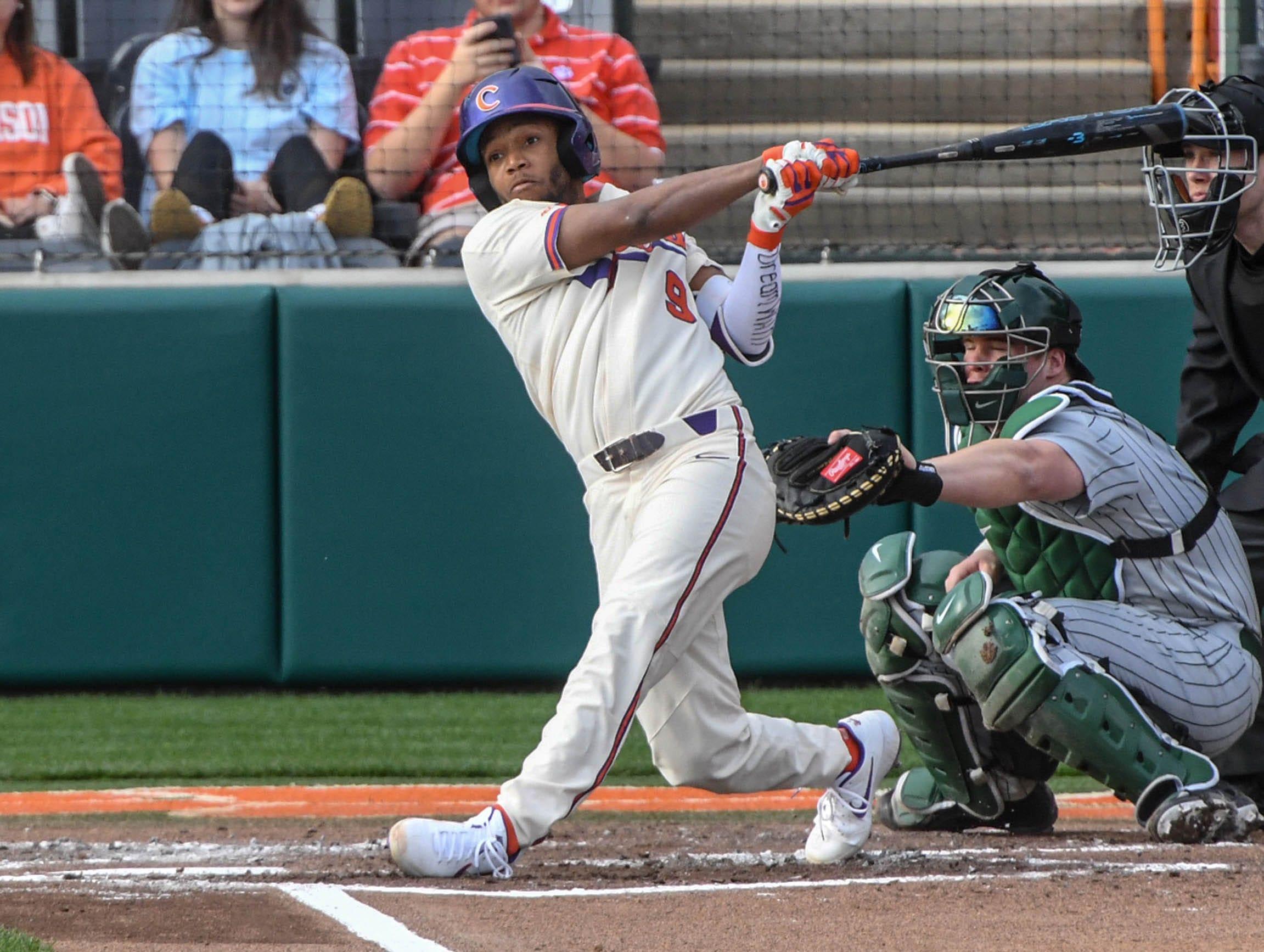 Clemson infielder Jordan Greene(9) hits a home run against Charlotte during the bottom of the second inning at Doug Kingsmore Stadium in Clemson Monday, February 18, 2019.