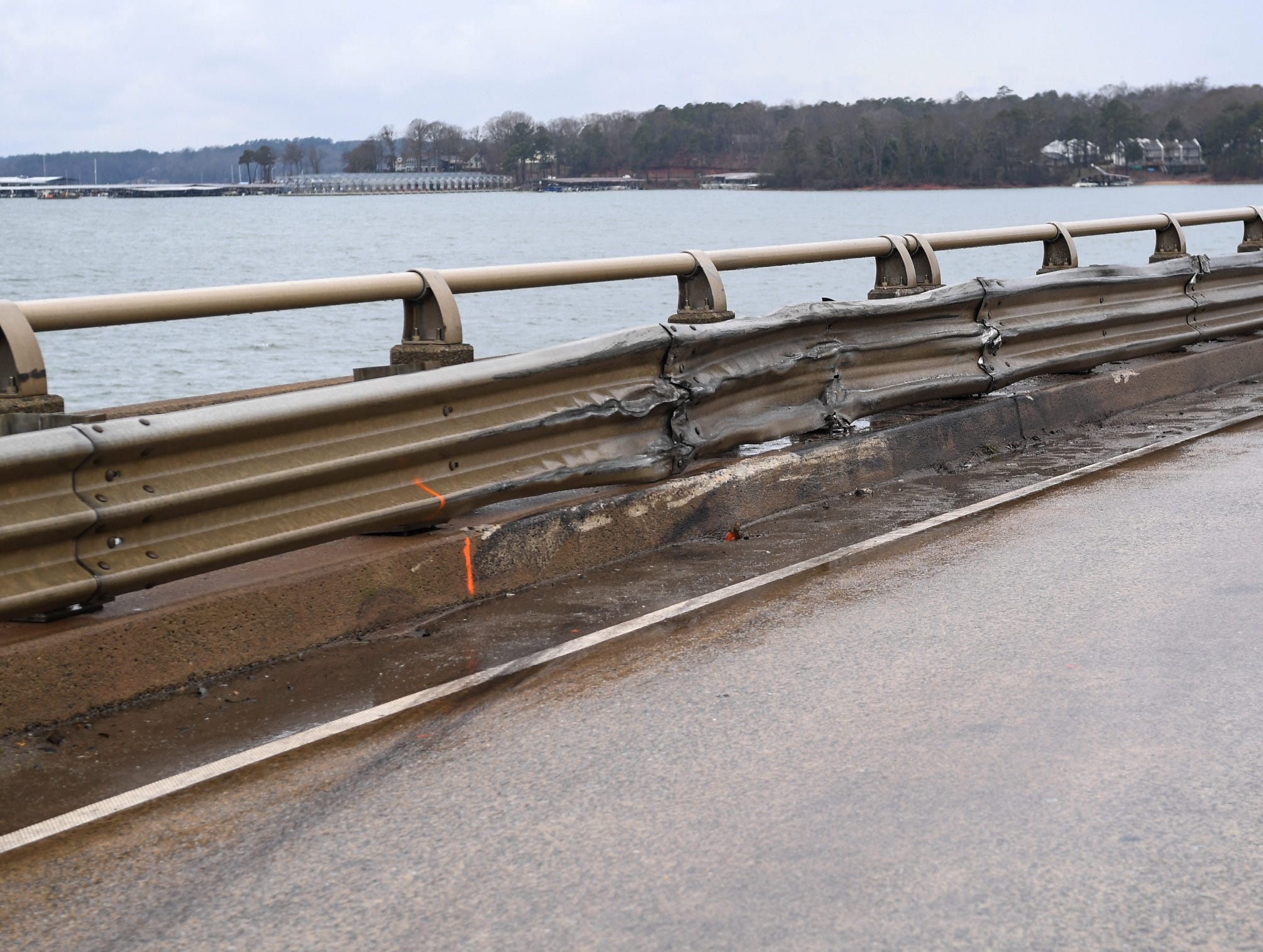A bridge on state highway 24 over Lake Hartwell, the site of an accident with a tractor-trailer carrying chickens and a grey sedan on Monday, is open with some damage to the guard rail Tuesday.