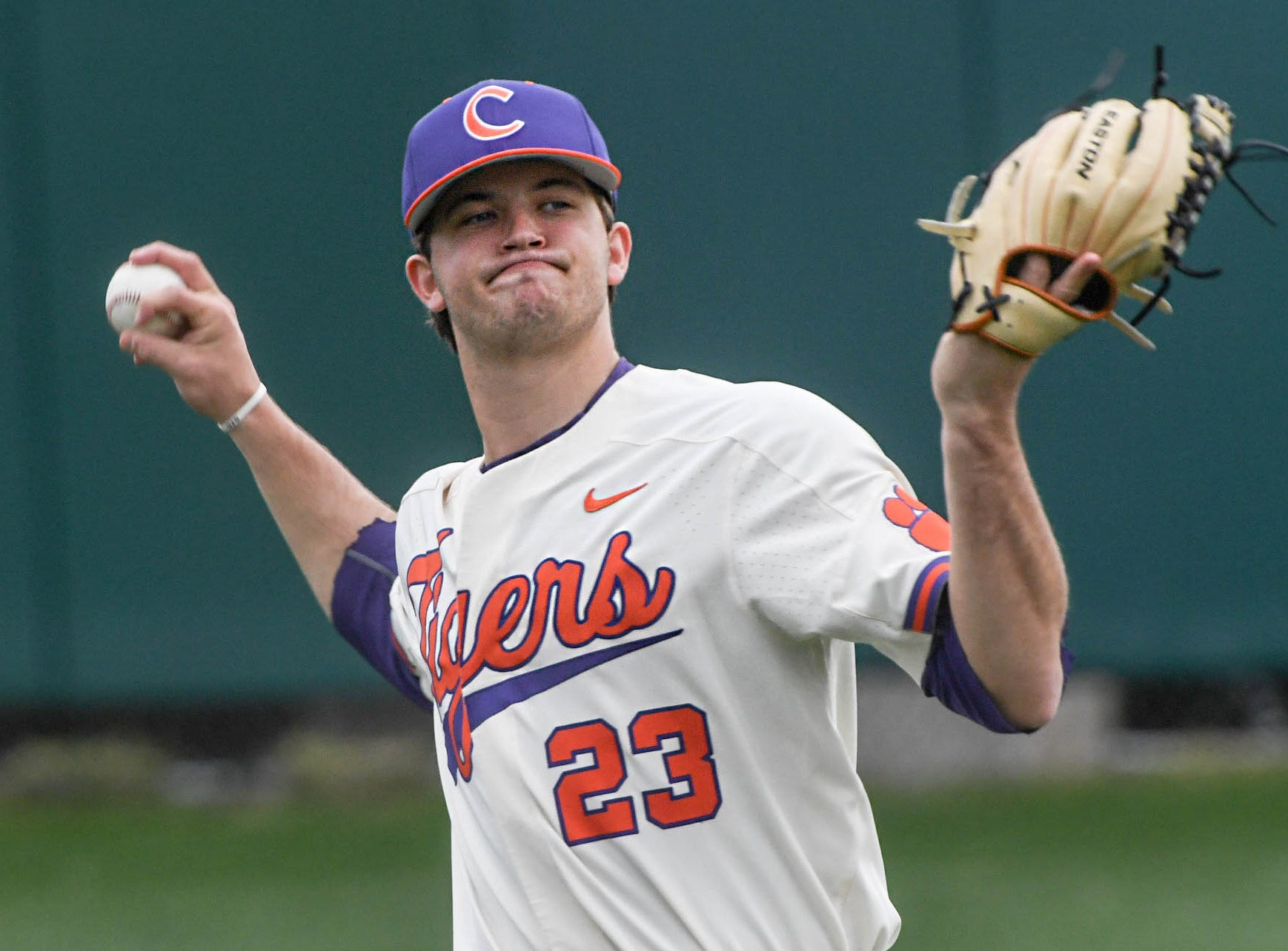Clemson junior Carson Spiers(23) warms up before the game with Charlotte at Doug Kingsmore Stadium in Clemson Monday, February 18, 2019.