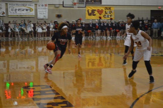 West Monroe guard Dezarae Stewart (23) dribbles through traffic against Natchitoches Central Monday in the Class 5A regionals.