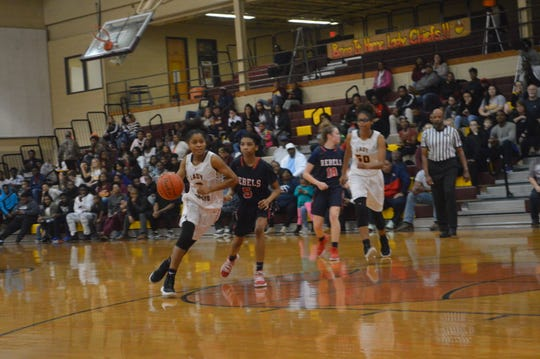 NCHS freshman guard J'unti Franklin (3) drives down the lane against West Monroe Monday in the Class 5A regionals.