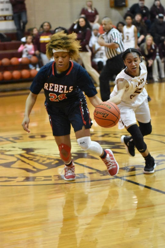 West Monroe's Dezarae Stewart (23) and NCHS' Teanna Payton battle for a loose ball during Monday's Class 5A regional.