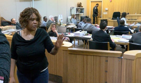 Narika Scott waves Jonelle Melton's family members after she testified at the murder trial of Ebenezer Byrd, Gregory Jean-Baptiste and Jerry Spaulding, in State Superior Court in Freehold Tuesday, February 19, 2019.  Scott, one of Byrd's girlfriends,  has testified Byrd admitted his role in the murder of the former school teacher to her.