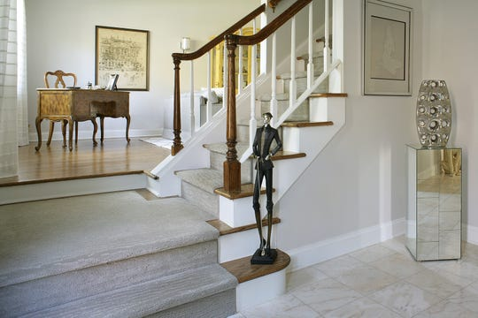 We started by tearing out the existing wall-to-wall carpets and refinishing the original hardwood floors, steps and banisters which we stained dark walnut, meeting the preference for hardwood floors in real estate today. We added rich architectural features by installing 6-inch crown and base moldings in every room.