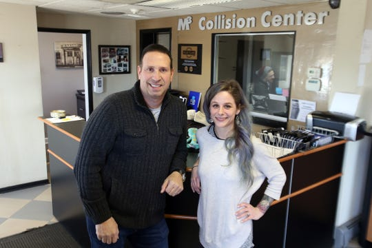 John D'Aniello, co-owner, and Katrina Joyce, manager, stand in the waiting area of M3 Collision Center in Neptune, NJ Tuesday, February 19, 2019.