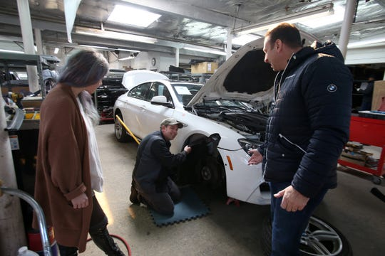 (center) Steve Potosky of Neptune City, a technician, explains how he will repair a customer's car to (right) John D'Aniello, co-owner, and (left) Katrina Joyce, manager, at M3 Collision Center In Neptune, NJ Tuesday, February 19, 2019.
