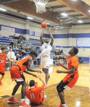 Big Spring's Jeremiah Cooley elevates for a shot in the paint Monday, Feb. 18, 2019, against Burkburnett in a Class 4A bi-district playoff at Stamford High School.
