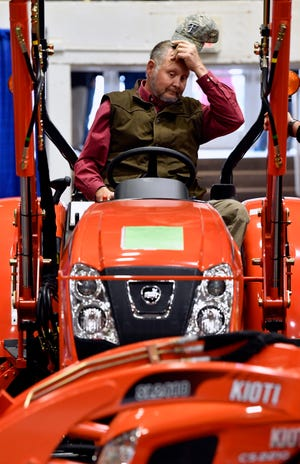 Randy Hanes of Sweetwater looks over a tractor during the trade show at Tuesday's Texas Farm-Ranch-Wildlife Expo in the Taylor County Coliseum. The show concludes Wednesday.