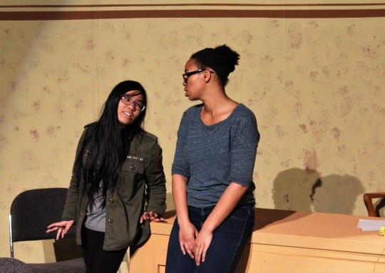 """Partner (Celine Nguyen, left) talks with Detective Beth Baker (Symone Fiedler)  in this rehearsal scene from McMurry University's winter show """"Detective Partner Hero Villain"""""""