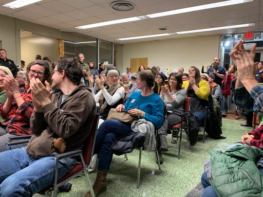 The crowd cheers after the Town of Marshall Board of Alderman pass the resolution.
