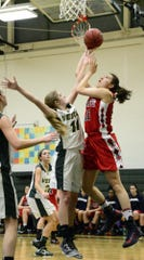 Binghamton High graduate Jodi-Marie Ramil, seen here scoring against Vestal in a 2012 game, helped Iona College to a 75-64 victory over Siena on Thursday in a MAAC tournament game.