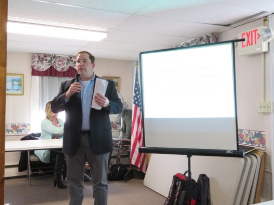Gregory Lieberman, senior project manager for Environmental Design & Research, explains the eastern Broome County proposed wind farm to a group of residents during a public information meeting in Windsor on Feb. 19, 2019