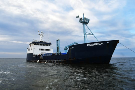 Scientists work aboard the M/V Ocearch anchored off Fernandina Beach