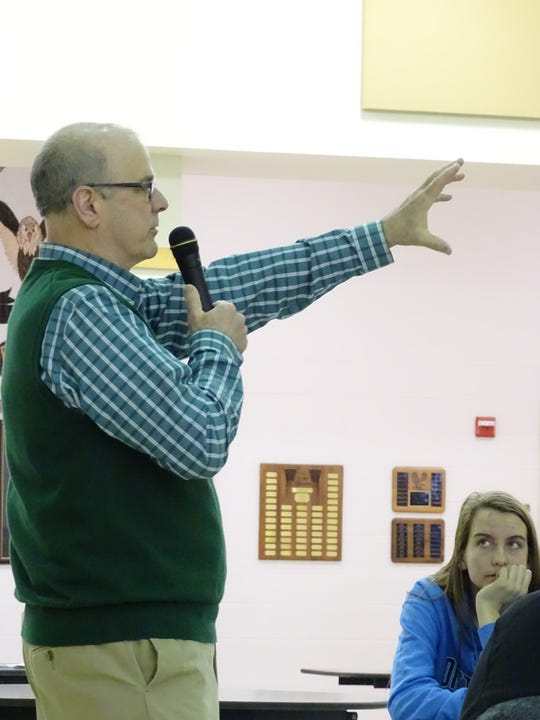 """Bucyrus Mayor Jeff Reser tells students at Colonel Crawford High School on Tuesday morning that after they go to college or get training, """"we want you to come back to raise your family."""""""