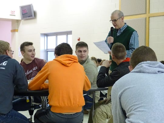 Bucyrus Mayor Jeff Reser speaks to students at Colonel Crawford High School on Tuesday morning.