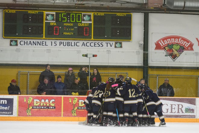 Essex huddles together during the girls hockey game between the Essex Hornets and the BFA-St. Albans Comets at Collins Perley Sports Complex on Monday night February 18, 2019 in St. Albans, Vermont.