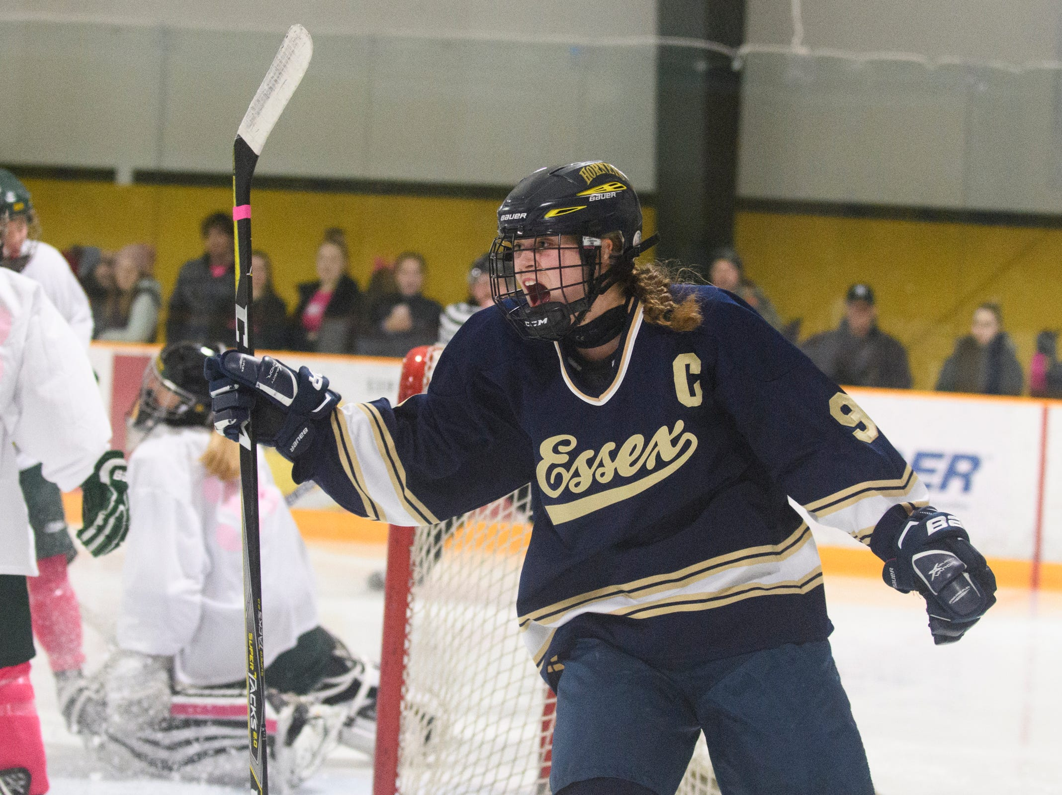 Essex's Olivia Miller-Johnson (9) celebrates a goal during the girls hockey game between the Essex Hornets and the BFA-St. Albans Comets at Collins Perley Sports Complex on Monday night February 18, 2019 in St. Albans, Vermont.