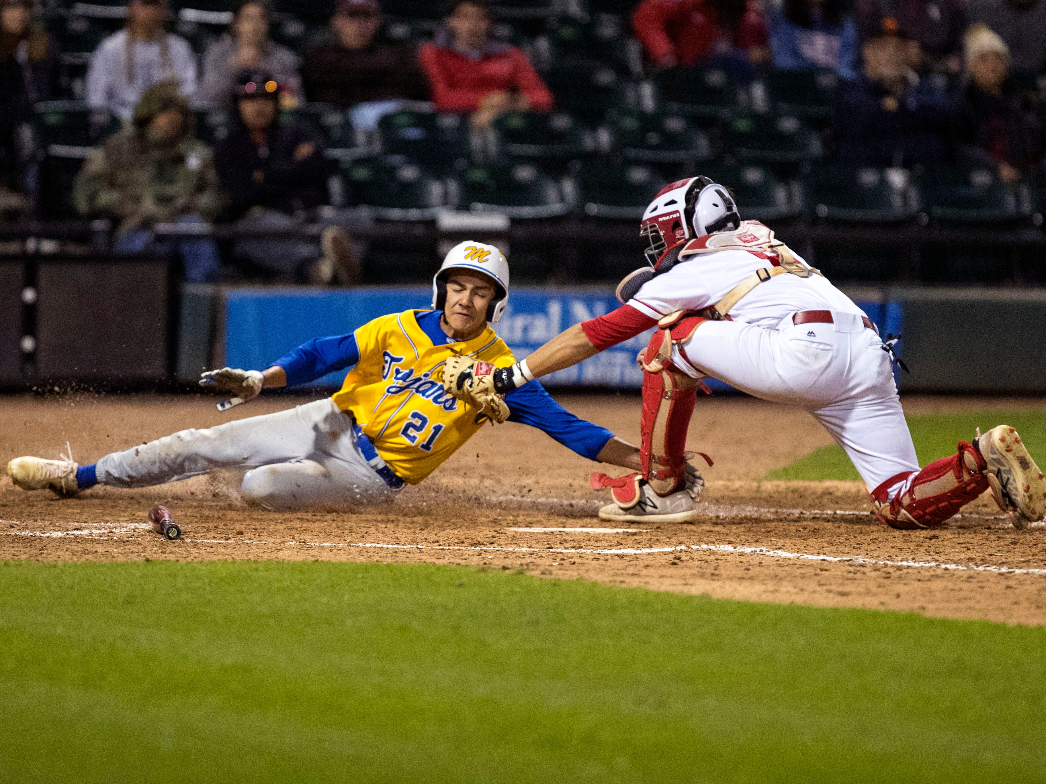 The Moody Trojans' Ryan Espinosa is out at home plate as Ray Texans pitcher Sam Canales gets the tag in during the sixth inning of the game at Whataburger Field on Monday, February 18, 2019. Moody took an early lead to beat Ray 7-3.