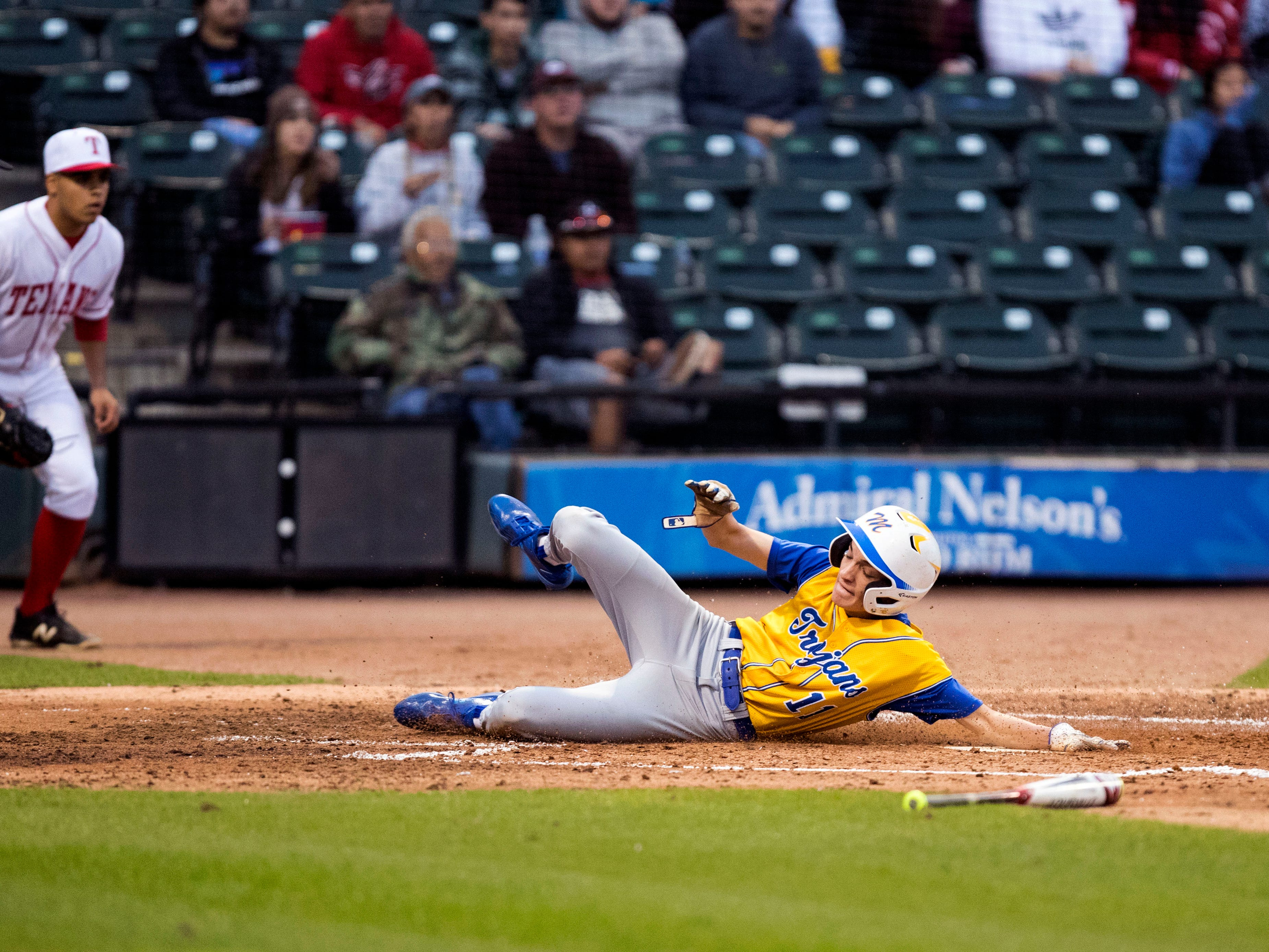 Moody Trojans' Tim Escamilla scores in the second inning of the game against the Ray Texans at Whataburger Field on Monday, February 18, 2019. Moody scored seven runs in the second inning and held onto the lead to beat Ray 7-3.