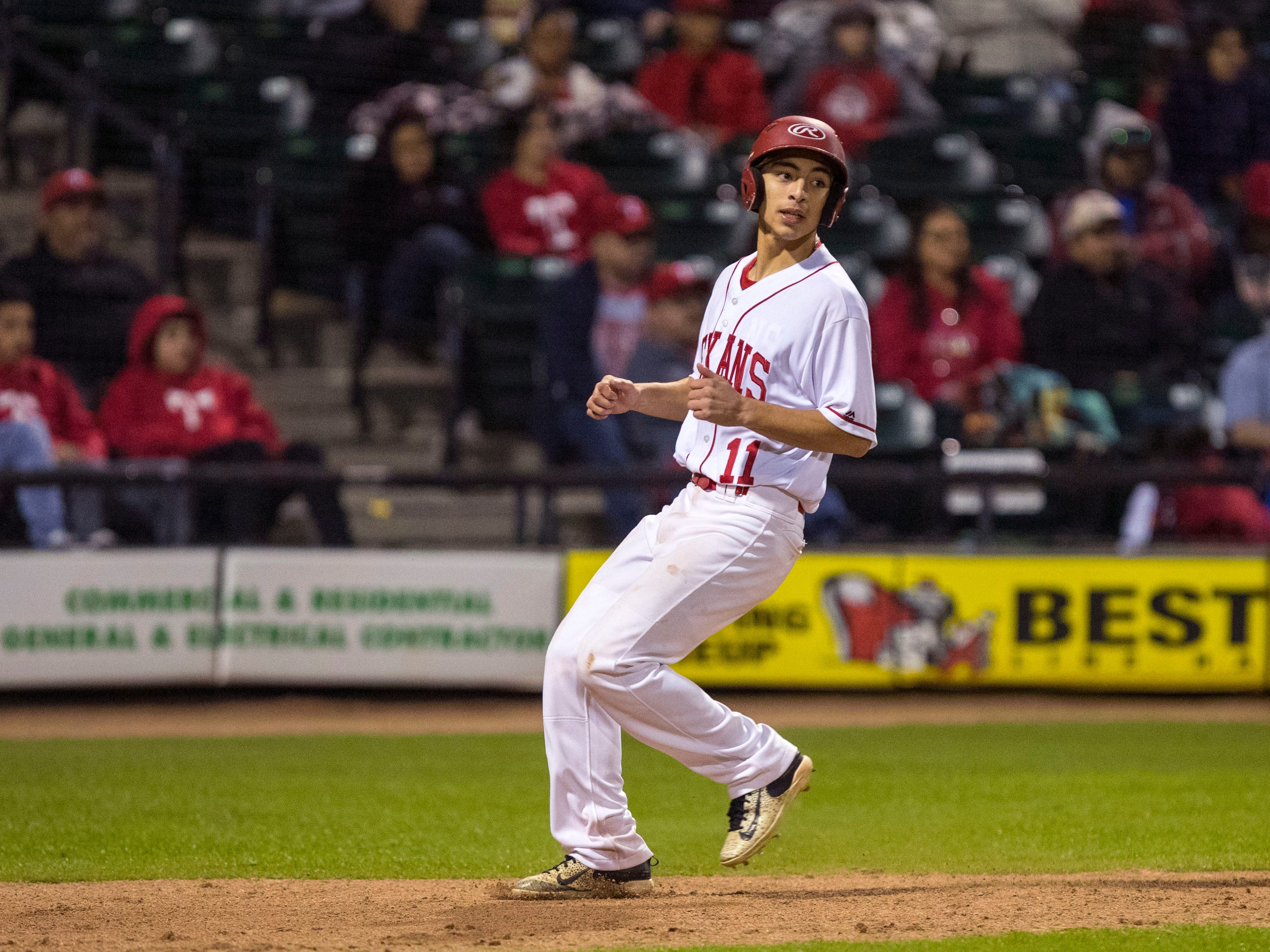 Ray Texans' Brandon Mejias scores a run in the sixth inning of the game against the Moody Trojans at Whataburger Field on Monday, February 18, 2019. Moody took an early lead to beat Ray 7-3.