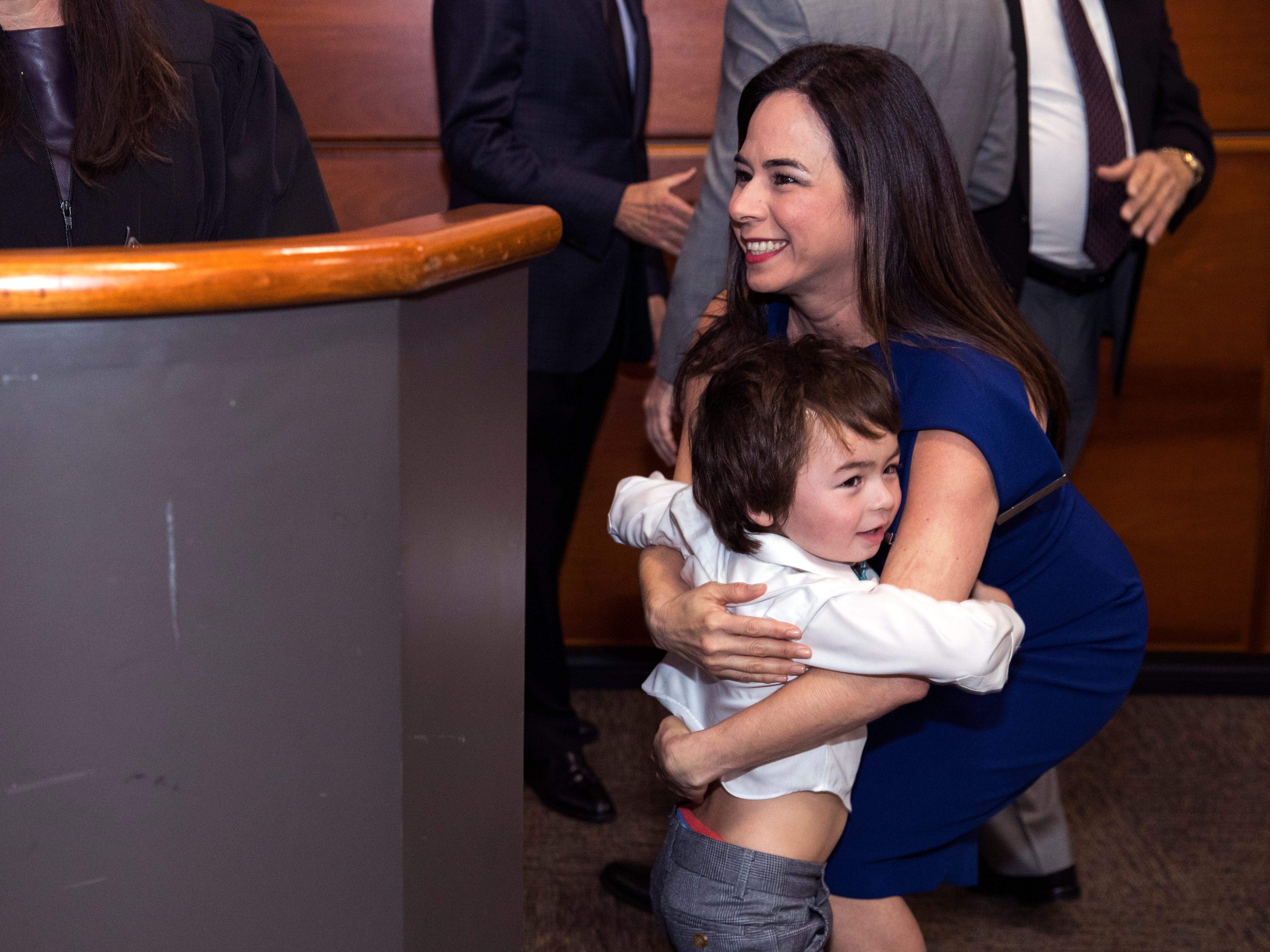 Catherine Tobin Hilliard hugs her son Dell Hilliard, 3, after being sworn in as Corpus Christi Port Commissioner, six of her seven children were there to see her sworn in, the other was away at college, on February 19, 2019, she will fill out the remainder of of Nueces County Judge Barbara Canales' term on the port commission, which ends Dec. 31, 2019.