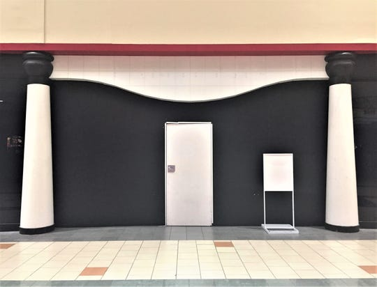 A vacant store presents a blank face to shoppers at the former Echelon Mall in Voorhees.