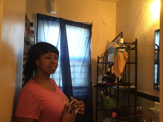 Lekeisha Stevens talks about problems in her unit in the Crestbury Apartments, including a small fire sparked by water leaking onto wires in her bathroom.