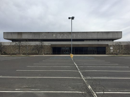 A parking lot outside a former Macy's store would change under a new redevelopment plan.