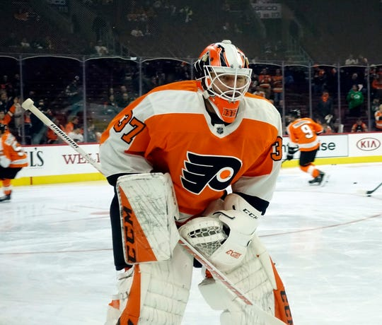Brian Elliott, who hadn't played in the NHL since mid-November, returned to the lineup Tuesday to back up Carter Hart.