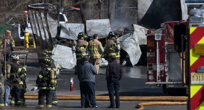 Police and fire crews respond to the scene of a fiery crash between a car and tractor-trailer that left one dead.  The crash occured behind a Home Goods and Marshalls on Route 38 in Moorestown on Tuesday afternoon.