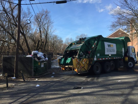 A Waste Management truck prepares to empty a Dumpster at the Crestbury Apartments on Tuesday. Residents had complained that trash was not being collected for weeks.