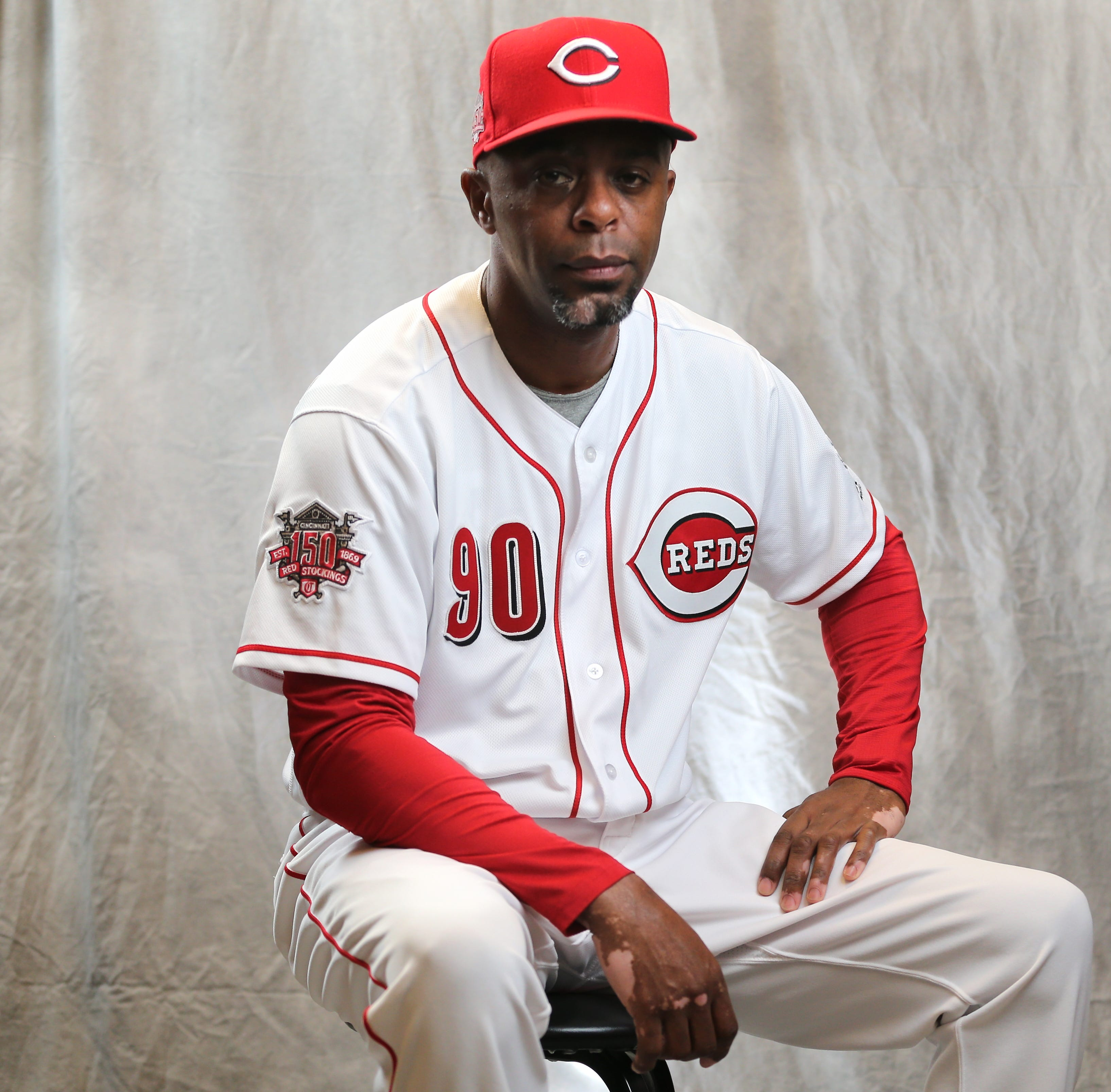 Cincinnati Reds first-base coach Delino DeShields enjoys father-son moment