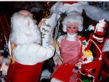 "The ""Santa's Workshop"" display at the Colerain Township home of Roy Dixon, who put up a massive Christmas lights display every year showed Santa and Mrs. Claus checking the list."